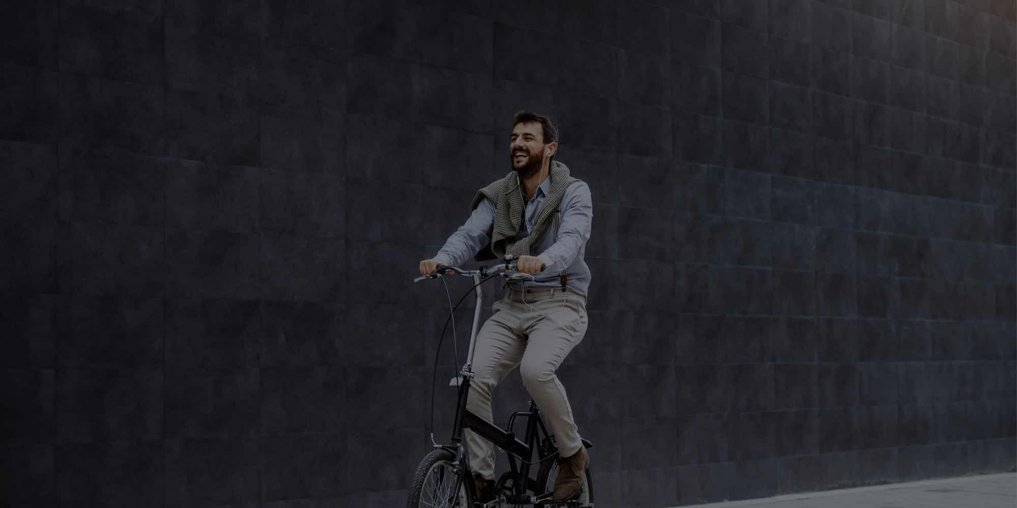 Man riding bike with smile on his face